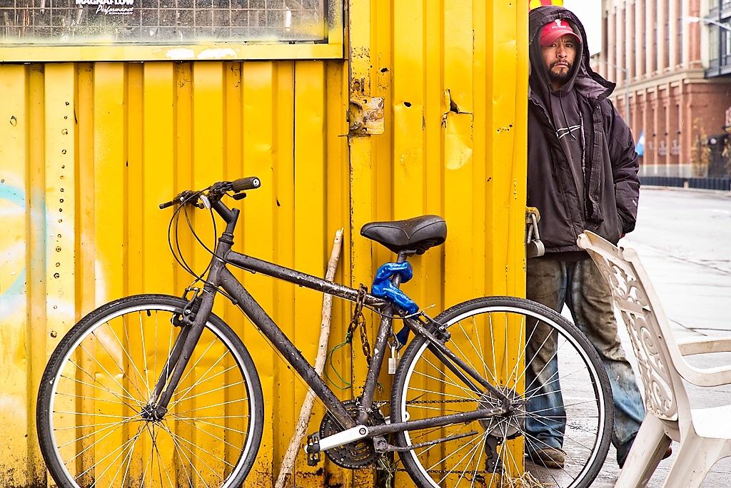 Bike, wall, man walking, yellow wall, street, story of a street