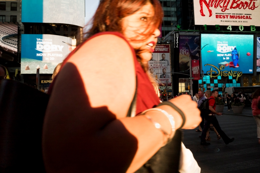 Street Photography Rush Hour In Times Square With Woman In Red Shirt